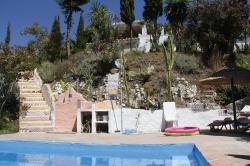 aanzicht huis vanaf piscina
